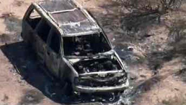 PD: Burned SUV with bodies is missing family's