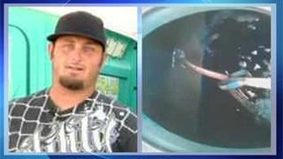 SLIDESHOW: Port-a-Potty worker gets slithery surprise