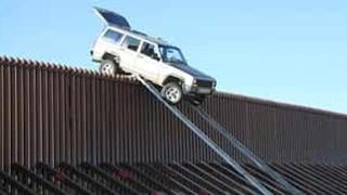 Border crossers stuck on fence