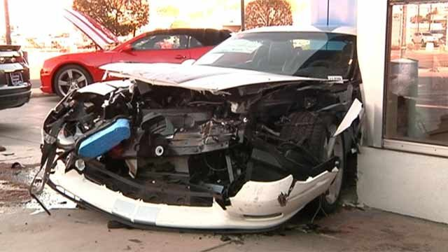 SLIDESHOW: Car slams into auto showroom