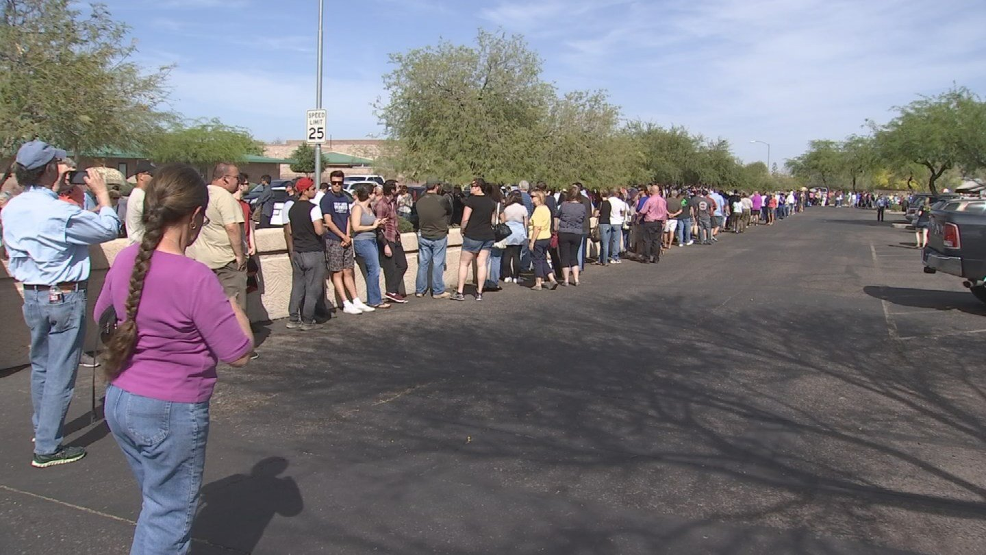 Voters waited in lines for hours due to reduced number of polling places (Source: KPHO)