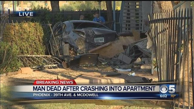 Driver killed after crashing into Phoenix apartment building