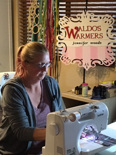 Jennifer Woods is the owner of Waldo's Warmers and gives to those in need. (Source: CBS 5 News)