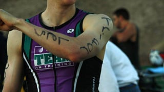 The markings on his arm read, &quot;Tri for Les&quot;