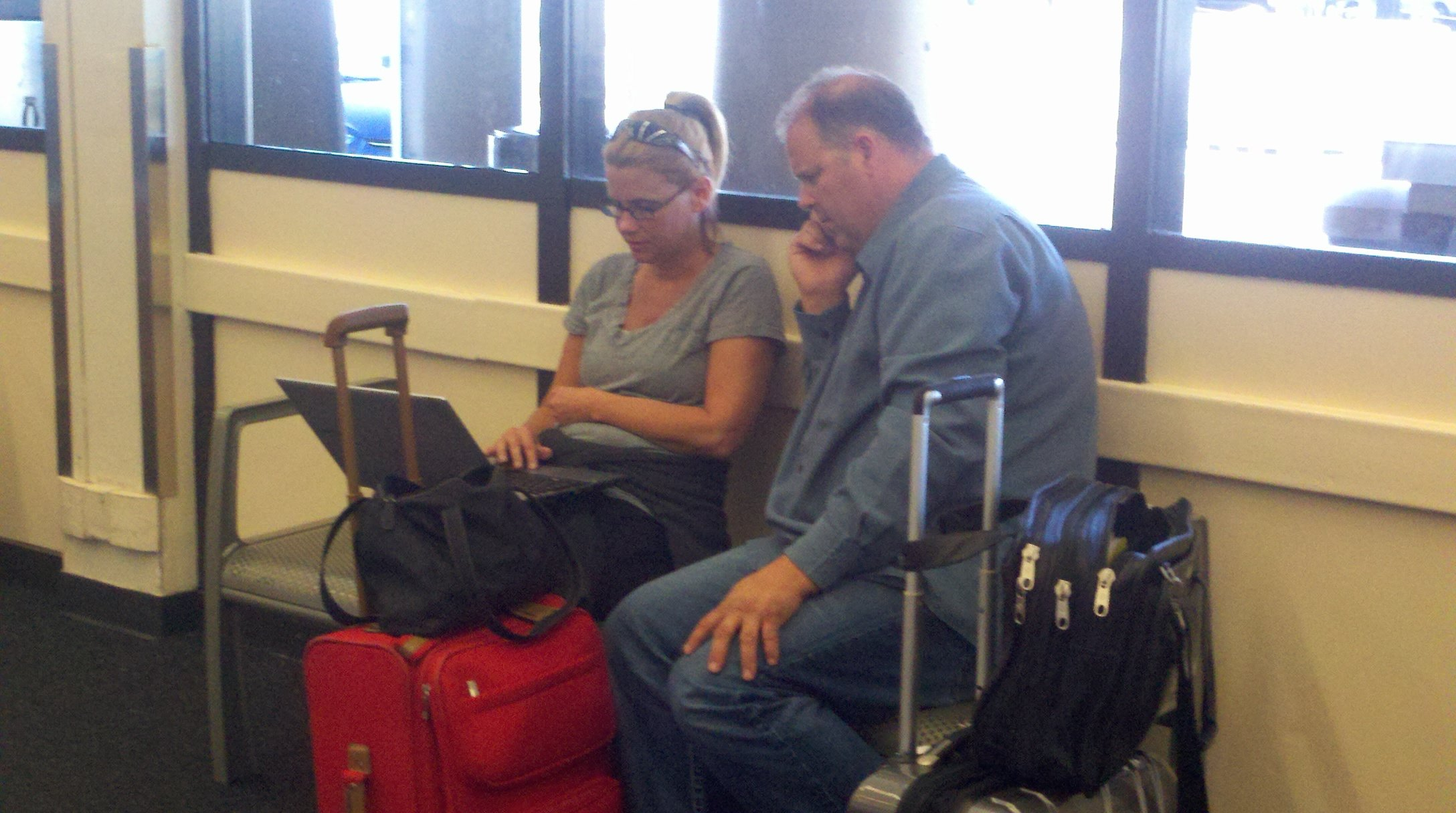 Texas-bound passengers wait out delays at Sky Harbor