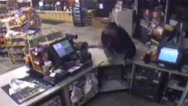Armed robber takes gun from under cashier's counter.