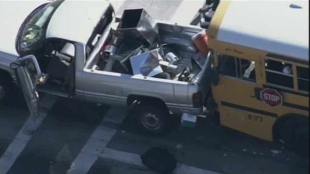 The bus struck the back of a pickup truck at the intersection.