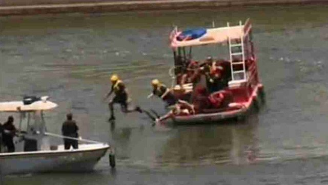 Tempe firefighters jump into the lake to subdue the elusive swimmer.