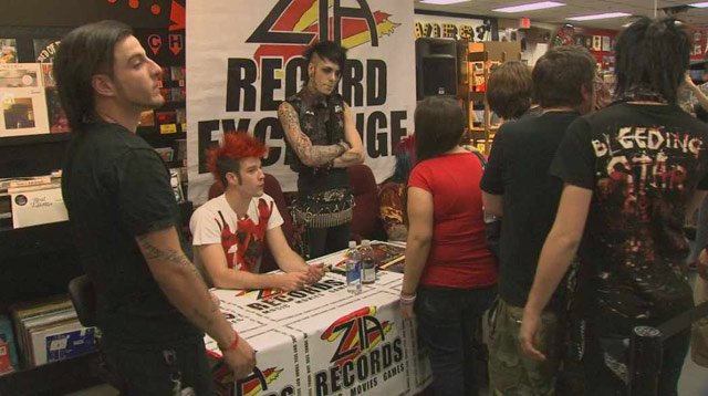 Electronic pop band Blood on the Dance Floor signs autographs in Phoenix on Thursday.