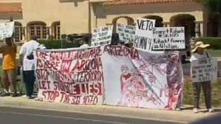 Protesters greet Mitt Romney in Scottsdale