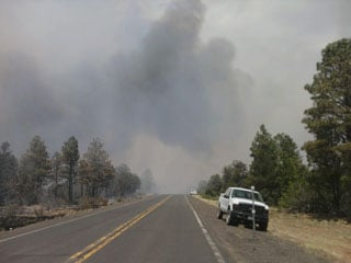 © (Courtesy: Coconino National Forest) Smoke on Highway 87 near the Canyon Fire