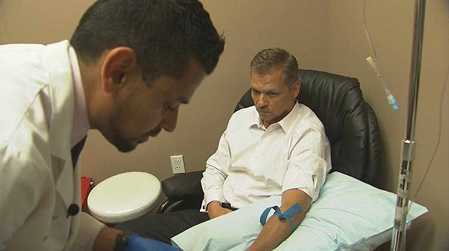 Dr. Suneil Jain treats bicycle rider David Kistner with an IV therapy known more for its hangover cure.