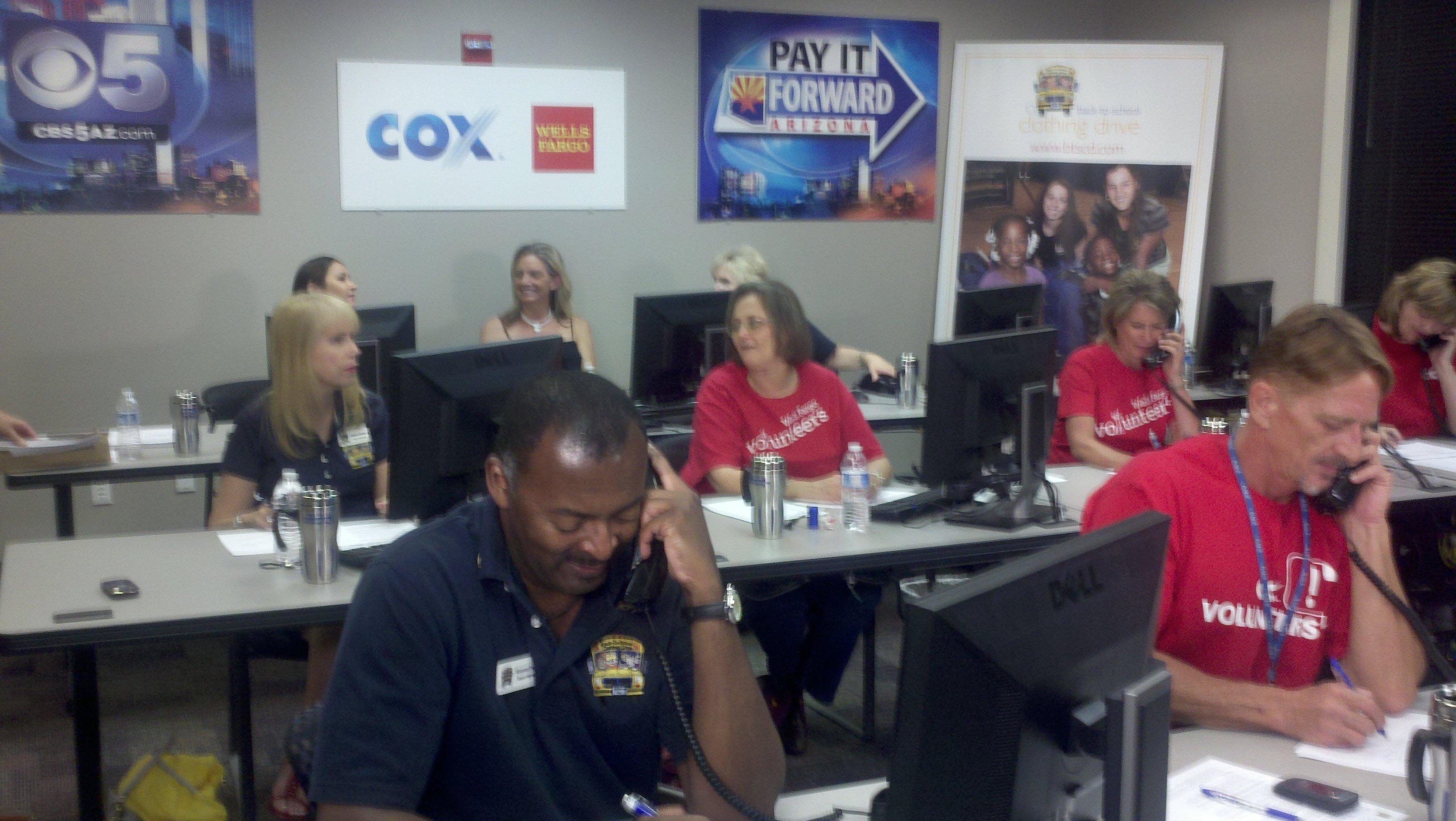 Volunteers answering phones on Friday.