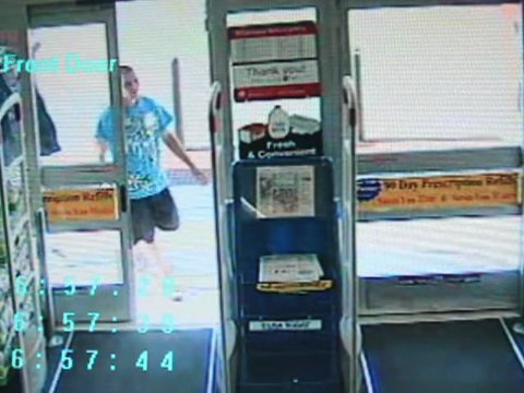 Surveillance video of one of the men entering the Walgreens.