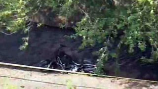A motorcycle lies in a north Phoenix canal after fatal crash Tuesday morning.