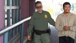 Border Patrol agent extraditing Lopez. (Photo courtesy of Customs Border Protection)