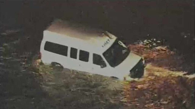 A medical transport van became trapped by floodwaters at a Scottsdale intersection.