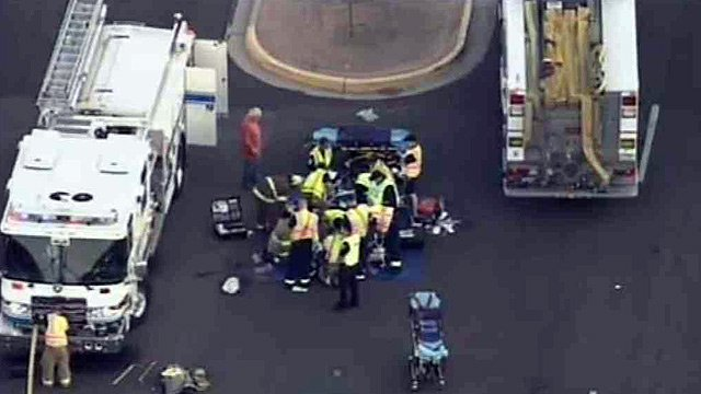 Paramedics attend to the injured in front of Mesquite High School in Gilbert.