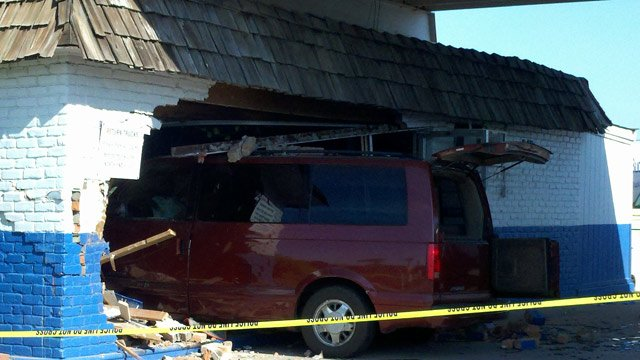 (Photo: Todd Jackson / CBS 5 News) A minivan plowed into a rental car building in Glendale on Thursday morning, slightly injuring four people.