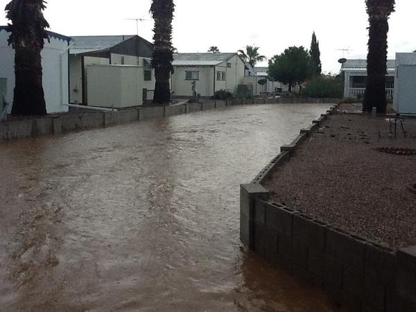 Residents of Sun Valley Mobile Home Park in Mesa watched as rains flooded areas near their residences.