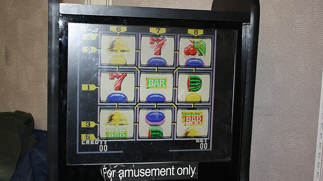 (Photo: Arizona Department of Gaming) Agents seized 54 eight-line gambling devices and five coin-pusher machines, all containing cash, from 40 sites around the Valley.