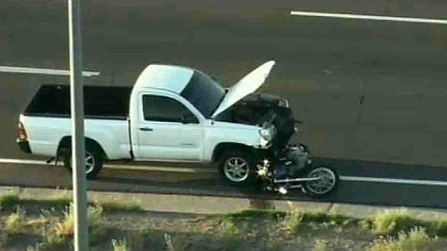 A motorcycle is trapped under a pickup in one of two crashes on the U.S. 60 in Apache Junction on Wednesday morning.