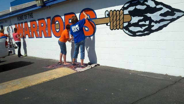 © Parents of Westwood High students volunteered to paint over the graffiti on Friday.