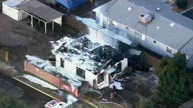 A Phoenix home was destroyed by fire, but a childcare center was spared damage due to the quick actions of firefighters Thursday morning.
