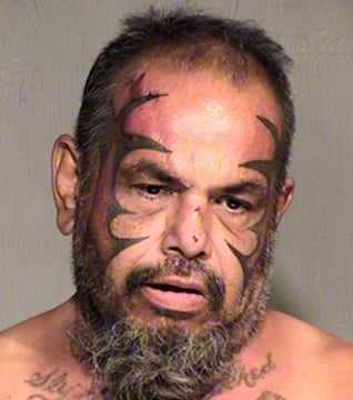 (Photo: Maricopa County Sheriff's Office) Robert Guillen Garcia, 50, told the manger of his living facility that he was attacked by his 56-year-old roommate with a knife.