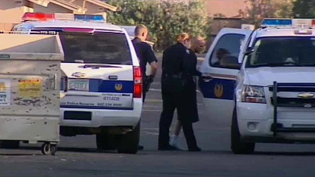 One of two men suspected of robbing a Phoenix Circle K store is loaded into a police vehicle after his arrest Monday morning.