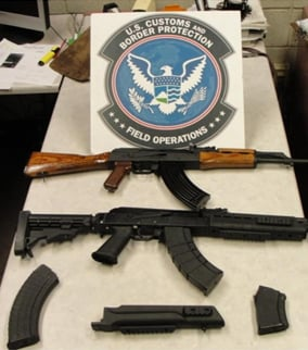 Two AK-47 assault rifles and magazines seized at the Port of San Luis.