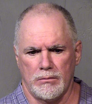 Steven Joseph Holland, 52, was arrested Oct. 11, 2012 at his Phoenix home near Happy Valley Road and 51st Avenue, culminating a 13-month investigation by Phoenix police. (Source: MCSO)