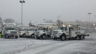 (Source: Salt River Project) Snow from Nor'easter falls on SRP trucks in NY.