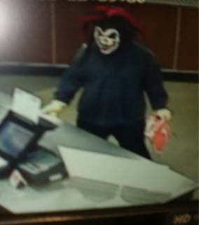 (Source: Surprise Police Department) Picture of the masked man taken by a surveillance camera.
