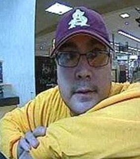 Another surveillance image of suspected bank robber