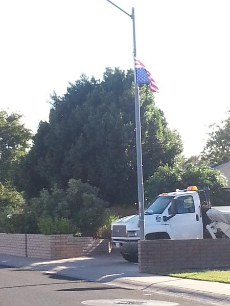 A veteran flies his US flag upside down as a way to protest.