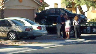 (Source: Sean Gates / CBS 5 News) Victim's car being towed from her garage