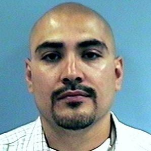 (Source: Maricopa County Sheriff's Office) Angel Padilla, a 35-year-old ex-convict with a violent past and ties to gangs, gave up after Phoenix police SWAT members stormed a house Sunday night.