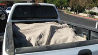 Tarp was used to cover the undocumented immigrants in the bed of a pickup truck. (Source: MCSO)