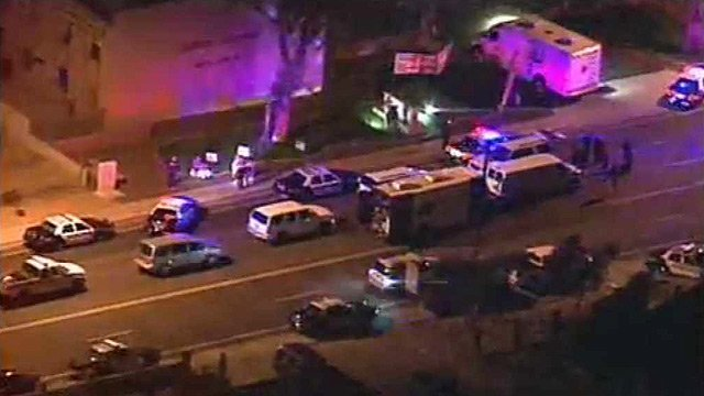 (Source: CBS 5 News) Mesa police closed 8th Street west of Country Club Drive while they negotiate with an armed man wanted  in connection with a shooting Monday.