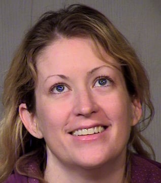 (Source: Maricopa County Sheriff's Office) Michelle Madarieta, also known as Ciara Coultrap, could face up to 30 counts of fraud with her husband, Michael Coultrap, below.