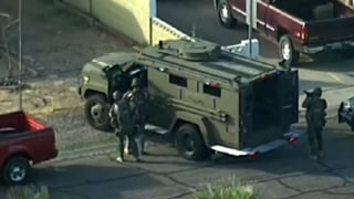 SWAT officers close in on man barricaded in Mesa home.
