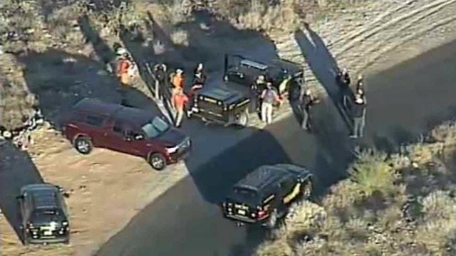 (Source: CBS 5 News) Searchers found the body of a person on a pile of rocks in a dry streambed in the White Tank Mountains.