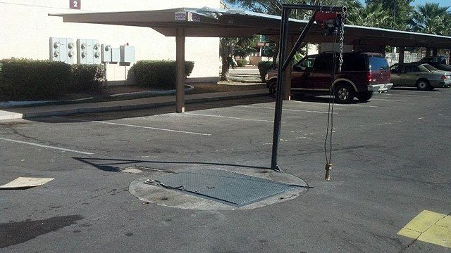 (Source: CBS 5 News) A maintenance worker overcome by fumes was rescued from this sewage hole in Glendale on Thursday.
