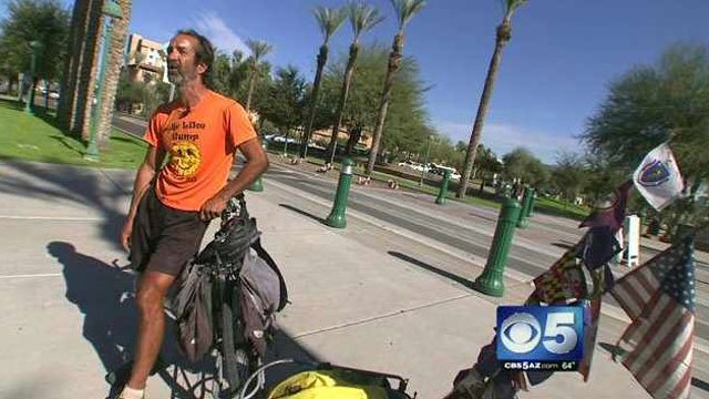 (Source: CBS 5 News) Romano Scatturro has ridden his bicycle to 49 of 50 U.S. state capitols to raise money to help two stricken individuals in Cornville.