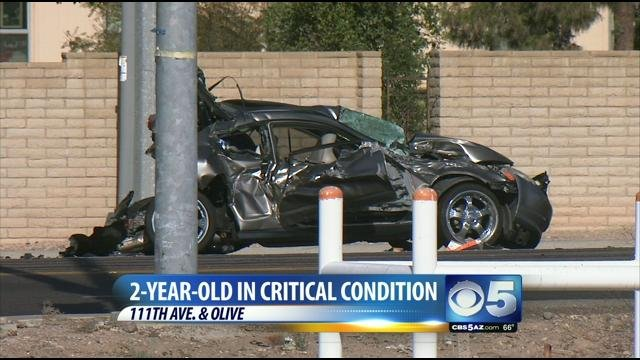 Car demolished in crash near 111th Avenue and Olive.