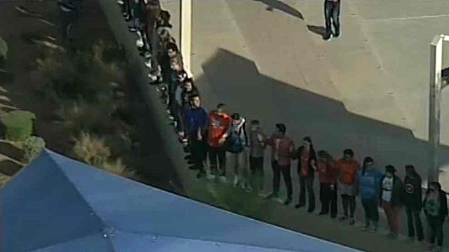 (Source: CBS 5 News) Students at Mesa's Westwood High School gathered just before 10 a.m. to hold hands in a show of support for their principal.