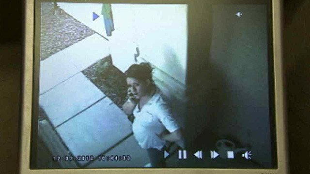 (Source: CBS 5 News) The woman looks right into the surveillance camera.