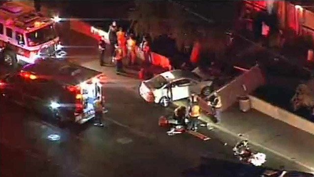 (Source: CBS 5 News) A 62-year-old woman apparently suffered from a medical condition when her car slammed into two people walking near a Phoenix bus stop early Wednesday.