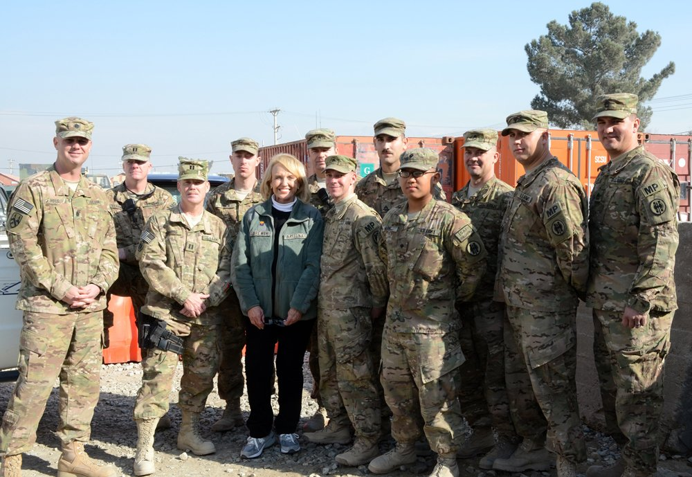 Arizona Gov. Janice K. Brewer poses with Soldiers deployed to Afghanistan with the U.S. Army Reserve 539th Military Police Detachment from Buckeye, AZ., Dec. 6, 2012, at Bagram Airfield. (U.S. Army photo by Staff Sgt. David J. Overson, 115th Mobile Publ
